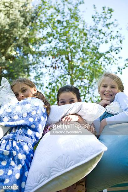young girls camping and pillow fighting. - ketchum idaho stock photos and pictures