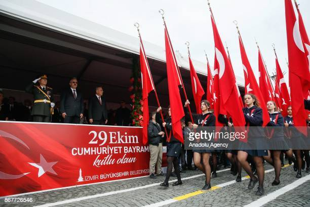 Young girls carry the Turkish flags as they march during the celebrations for the 94th Anniversary of Republic Day at the Izmir Cumhuriyet Square in...
