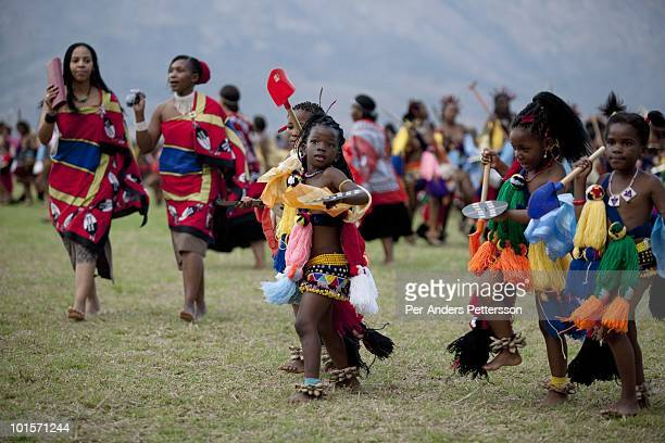 Young girls dance at a traditional Reed dance ceremony at the stadium at the Royal Palace on August 30 in Ludzidzini Swaziland About 80000 virgins...