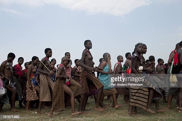 Young girls dance at a traditional Reed dance ceremony at the stadium at the Royal Palace on August 31 in Ludzidzini Swaziland About 80000 virgins...