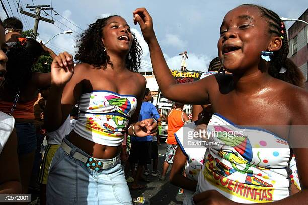 Young girls dance through the streets during Carnival on February 7 2005 in Salvador Brazil Centuries of slave trade with Central and West Africa has...