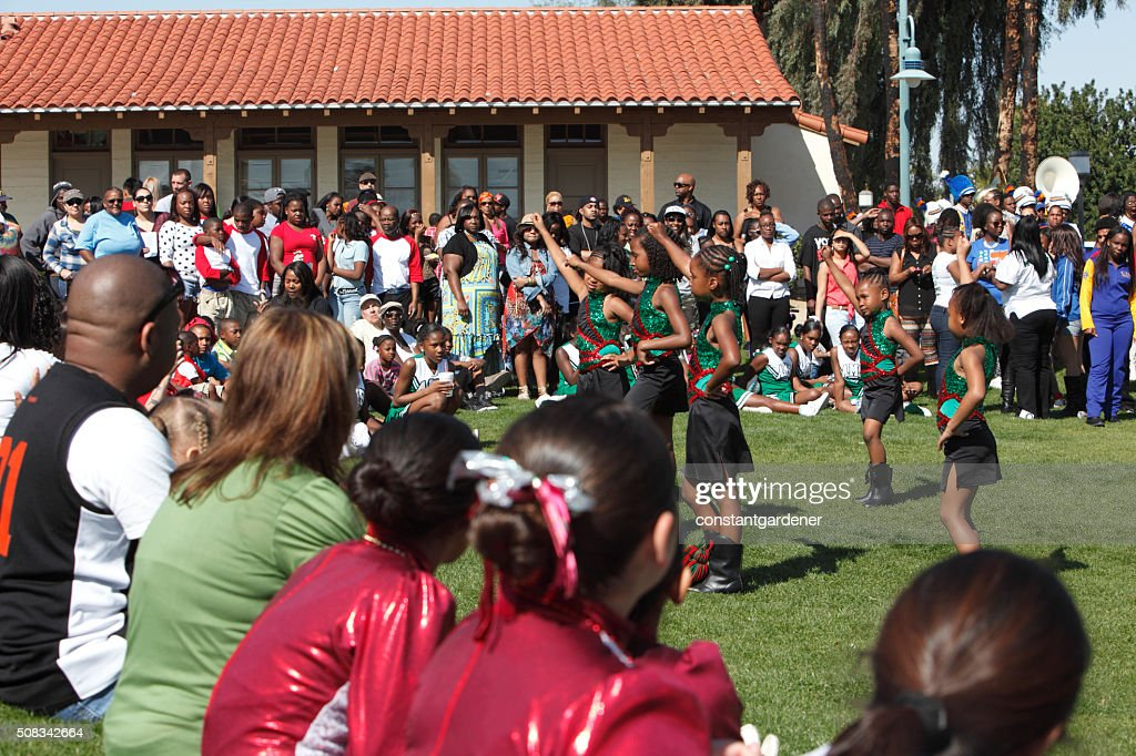 Young Girls Dancing Outdoors At Black History Celebration : Stock Photo