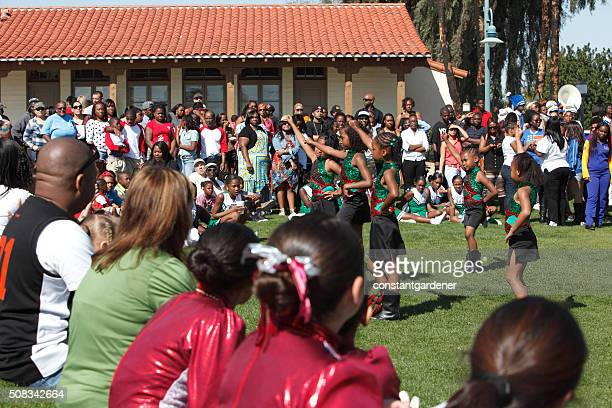 Young Girls Dancing Outdoors At Black History Celebration