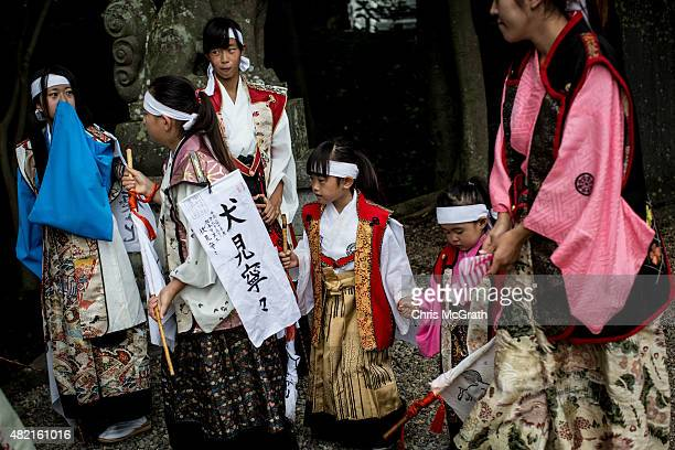 Young girls dressed in traditional clothing wait to enter the Nakamura Shrine during a Samurai ritual on July 24, 2015 in Soma, Japan. Every summer...