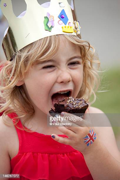Young girls eating cake at jubilee party