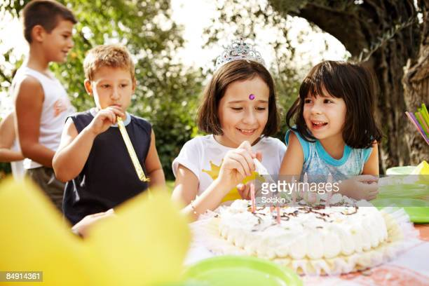 young girls enjoying cake at kids party - happybirthdaycrown stock pictures, royalty-free photos & images