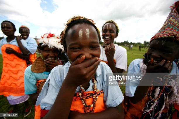 Young girls from a dance group using dance to discuss AIDS gather after a church meeting December 2006 in Kisumu Kenya HIV rates in Kenya are now at...