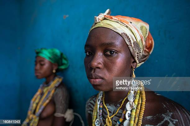 Young girls from the Krobo tribal group wear traditional beads. I photographed the dipo ceremony of the Krobo people. Africa many cultures celebrate...