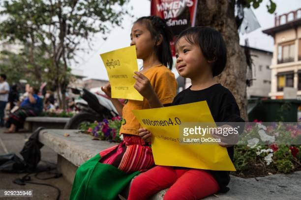 Young girls hold 'Women 40 signs at Tha Pae Gate during the annual International Women's Day event on March 8 2018 in Chiang Mai Thailand Hundreds of...