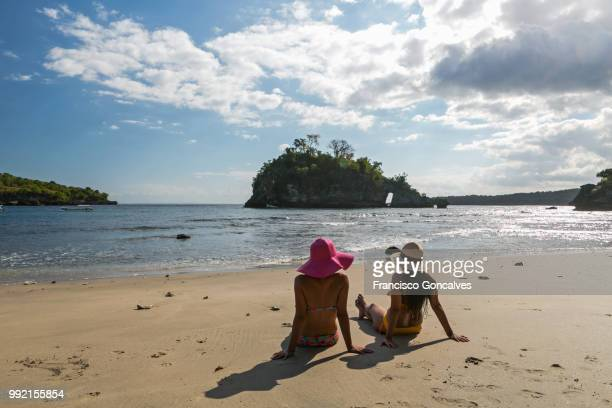 Young girls in a beach of Nusa Penida, Bali