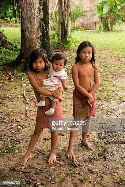 Young girls in a village on the Amazon River Peru