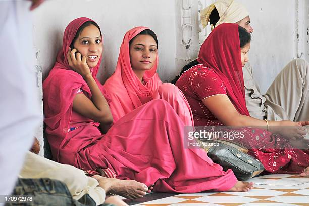 Young girls in the compound of the Golden Temple Amritsar Punjab India