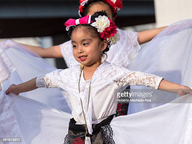 SQUARE TORONTO ONTARIO CANADA Young girls in white dress performing the Flamenco folk dance at MexFest 2015 in Toronto MexFest 2015 is celebration of...