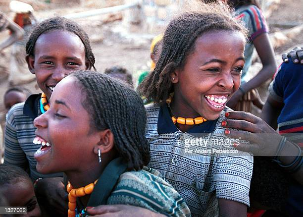 Young girls laugh together February 9 2001 in the Erer Valley in eastern Ethiopia Villagers in the Muslim area have started a campaign against female...