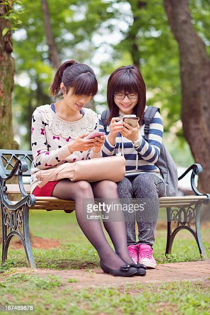 Young girls looking at smart phone