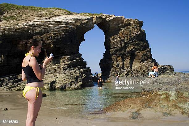 Young girls making pictures in Las Catedrales beach. Ribadeo. Lugo. Rias Altas. Galicia.