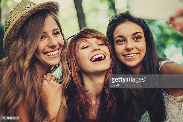 Young girls making selfie with smart phone