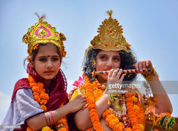 SRINAGAR JAMMU KASHMIR INDIA Young girls participates in Rally procession dressing as Krishna and Radha symbolising love on the occasion of...