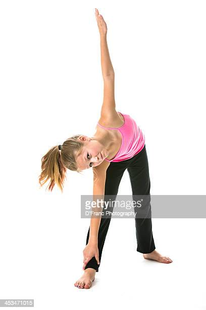 young girls performs yoga