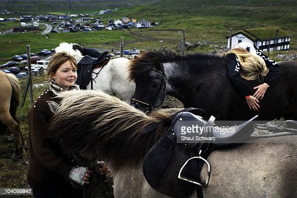 Young girls pet their horses after a horse race during St Olav's Day The National Festival in Torshavn the capital of the Faroe Islands July 29 2007...