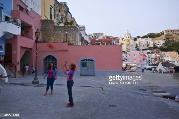 Young girls play at Marina di Corricella on June 11 2012 in Procida Italy
