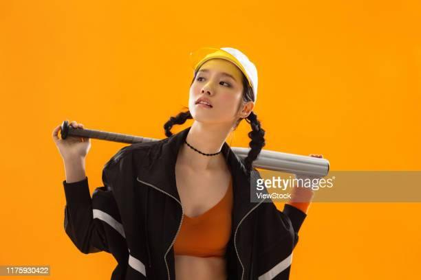 young girls play baseball - china east asia stock-fotos und bilder