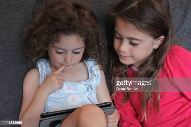 Young girls playing on a tablet