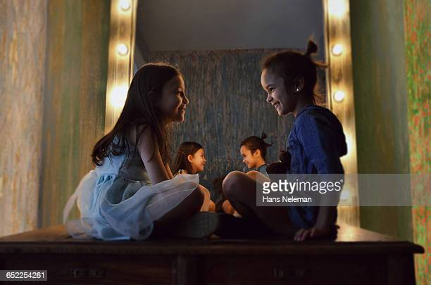 young girls playing with dolls - dolly golden stock pictures, royalty-free photos & images
