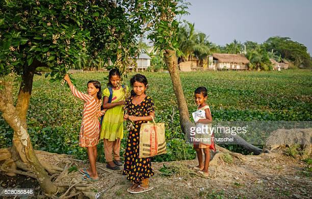 Young girls pose for a photo near the Mayur River on April 11 2016 in Khulna Bangladesh