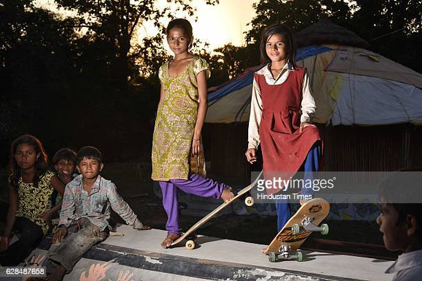 Young girls pose with their skate boards at Skating park popularly known as Janwaar Castle on October 26 2016 in Janwaar India Thanks to a German...