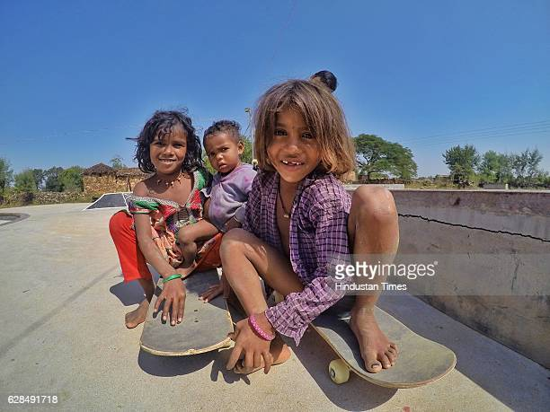 Young girls pose with their skateboards at Skating Park, popularly known as Janwaar Castle, on October 26, 2016 in Janwaar, India. Thanks to a German...