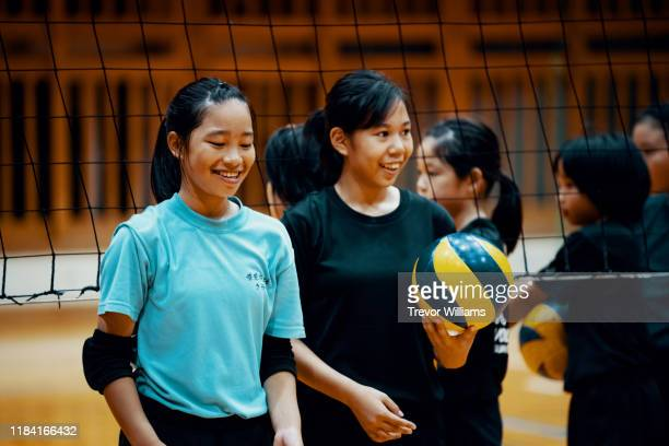young girls practicing volleyball - sports training drill stock pictures, royalty-free photos & images