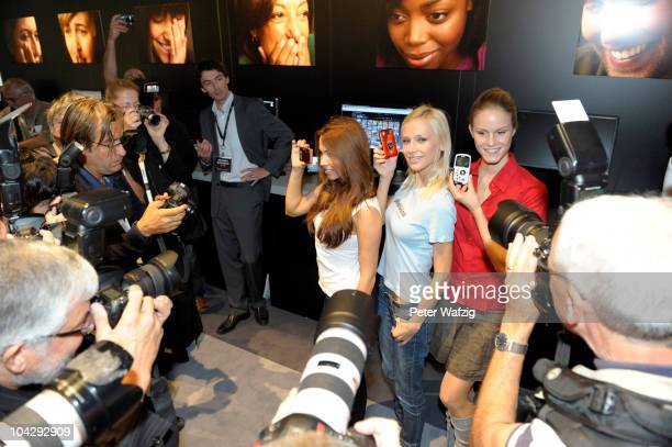 Young girls present New Kodak cameras during the press preview of the Photokina 2010 trade fair on September 20 2010 in Cologne Germany The photokina...