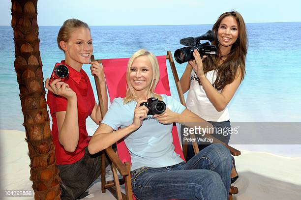 Young girls present new Sony cameras during the press preview of the Photokina 2010 trade fair on September 20 2010 in Cologne Germany The photokina...