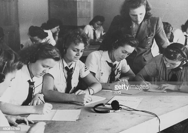 Young girls recruited to Hitler Youth being trained as telegraph operators during World War Two Germany circa 19391945