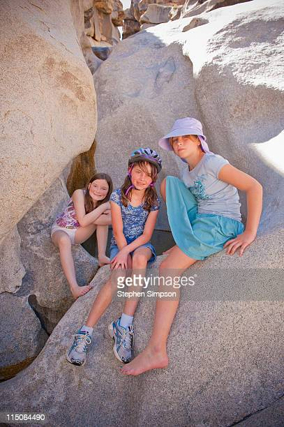 3 young girls relaxing on boulders