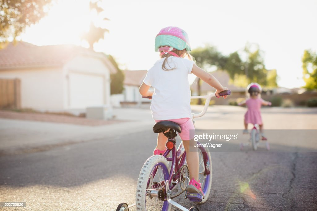 Young Girls Riding Bikes : Stock Photo