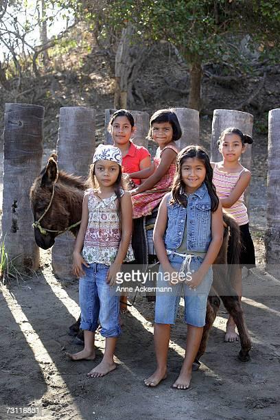 Young girls (4-9) riding donkey