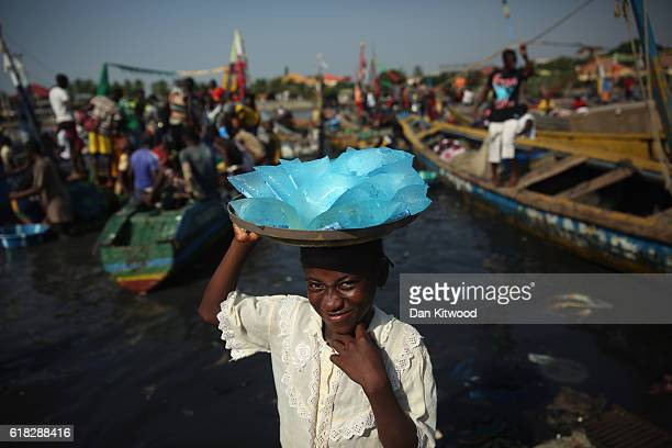 A young girls sells drinking water in a fishing market on November 19 2015 in Conakry Guinea Guinea is currently counting down the necessary 42 days...
