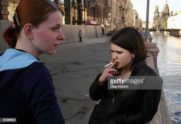 Young girls stand at the Griboedov channel May 29 2003 in St Petersburg Russia Russian President Vladimir Putin has invited some 40 world leaders to...