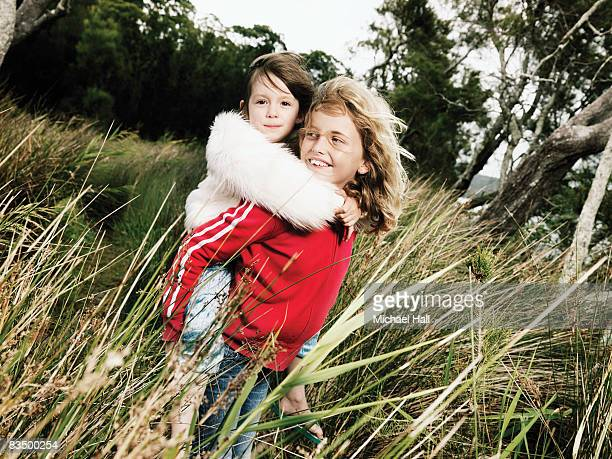 Young girls standing in reeds