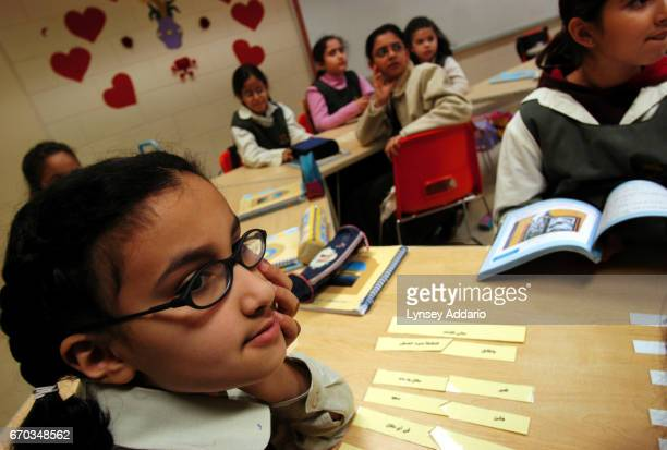 Young girls study in class at the Kingdom school in Riyadh Saudi Arabia December 2003