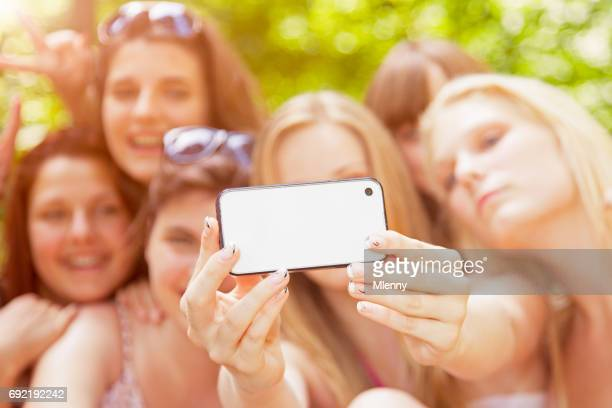 young girls taking group selfies in summer vacation - girl band stock pictures, royalty-free photos & images