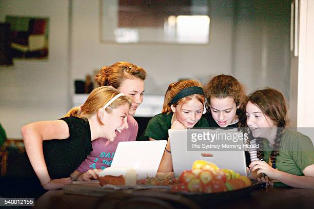 Young girls using computers from left Alice Tims Claudia Perry Lauren Collee Gina Wagstaffe and Claudia Scandal 21 June 2006 SMH Picture by NATALIE...