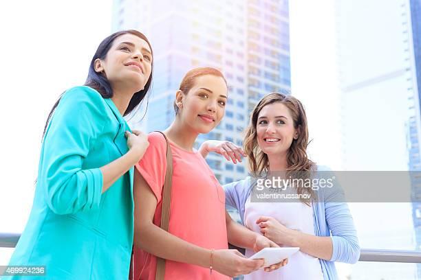 Young girls using digital tablet  in Dubai