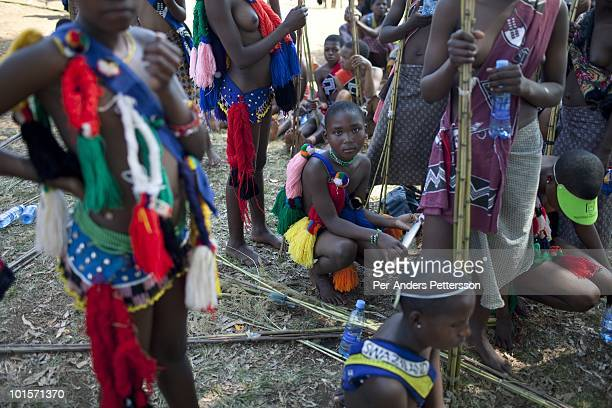 Young girls wait to dance at a traditional Reed dance ceremony at the Royal Palace on August 30 in Ludzidzini Swaziland About 80000 virgins from all...