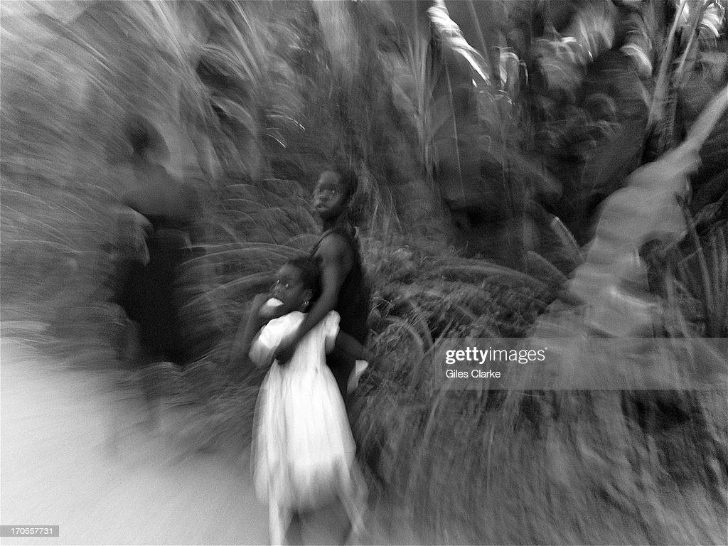 Young girls walk in the hills March 22, 2013 in Jacmel, Haiti.