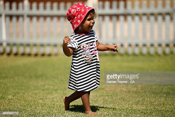 A young girls walks Albrecht Oval on February 14 2015 in Alice Springs Australia