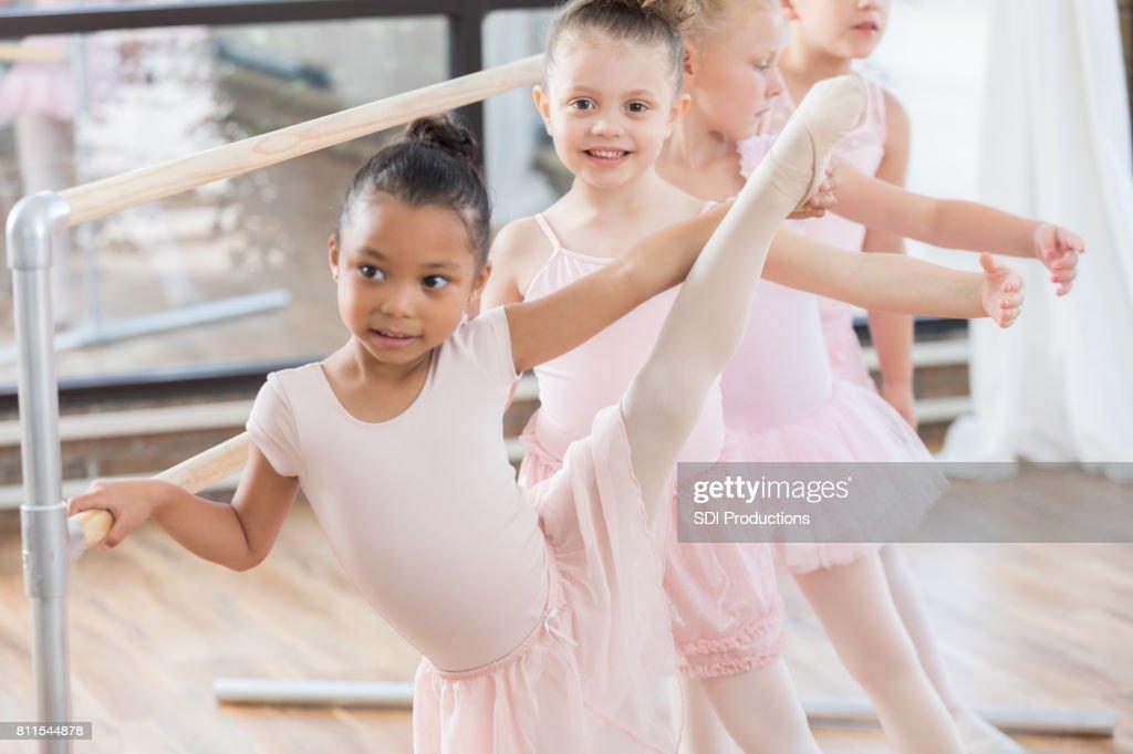 2841c8de5028 Young Girls Warm Up Before Ballet Class Stock Photo