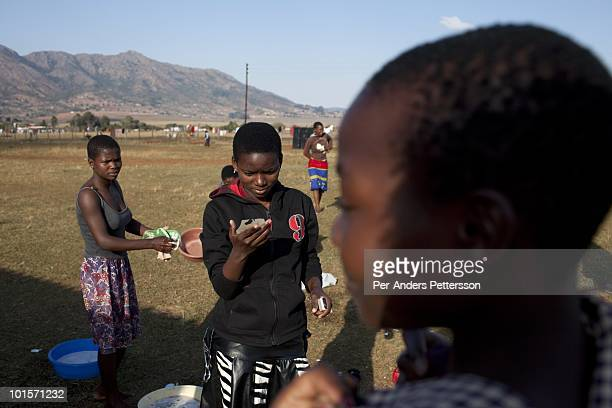 Young girls wash themselves before at a traditional Reed dance ceremony at the stadium at the Royal Palace on August 28 in Ludzidzini Swaziland About...